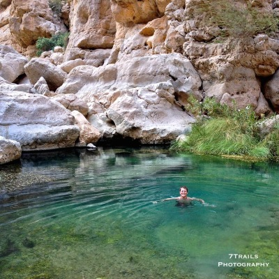 Swimming in the spring at the head of the Wadi Shab